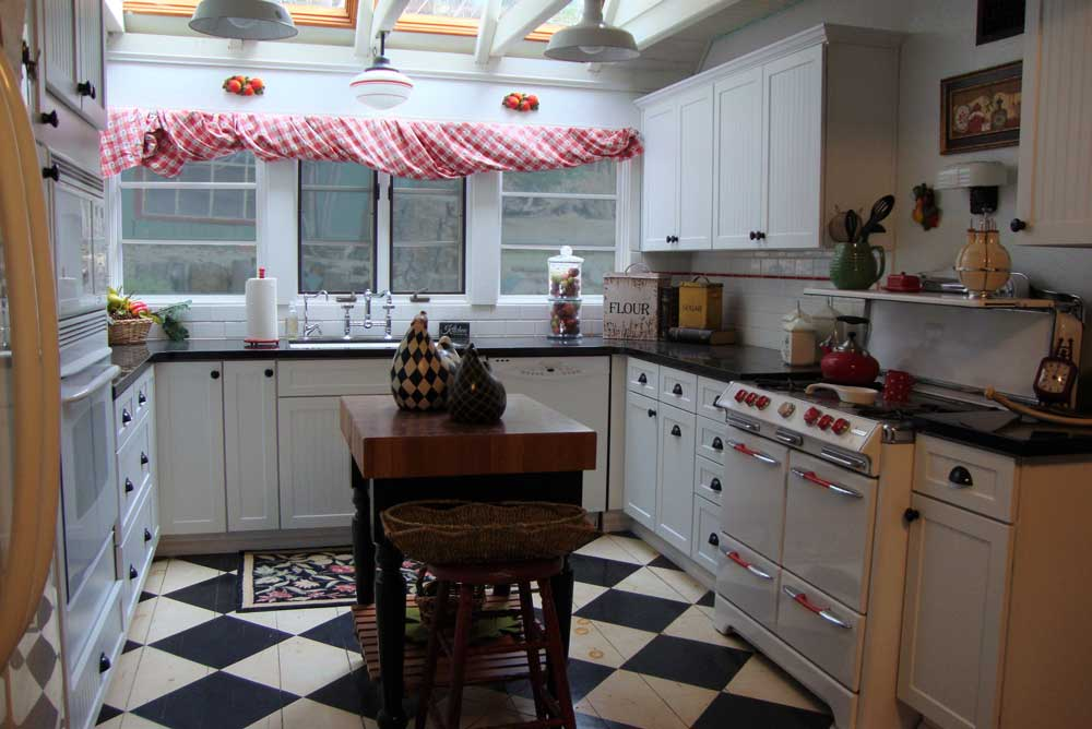 the kitchen with the painted wood floor